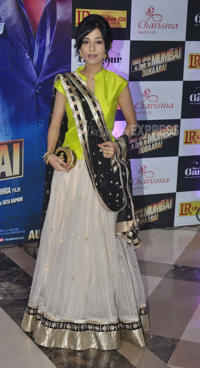 Another Anita Dongre outfit for the evening. Actress Amrita Rao, who will be soon seen in Satyagraha, wore a white lehenga with neon choli. We must say a very bold colour for the night. (Photo: Varinder Chawla)