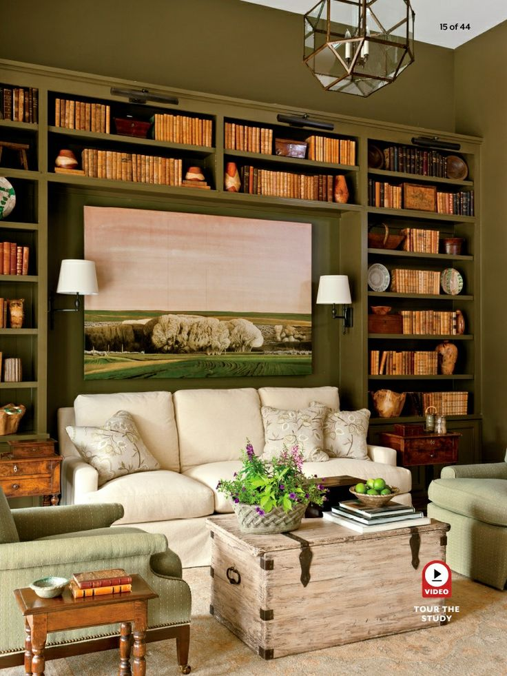 Sofa and sconces tucked in between bookcases