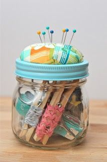 Great organization idea.  Pegs with small pieces of ribbon/trim.  Spray paint the top of a jar lid.  I've got to start saving my jars.