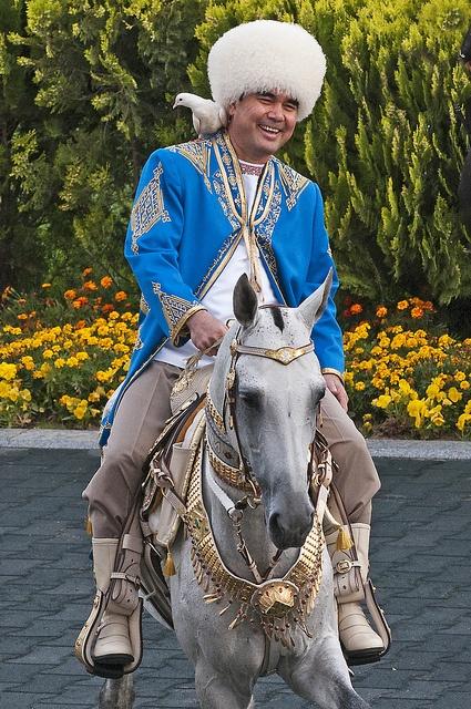 President Gurbanguly Berdimuhamedov of Turkmenistan riding his favourite #Akhal-Teke #stallion. Notice the dove on his shoulder.