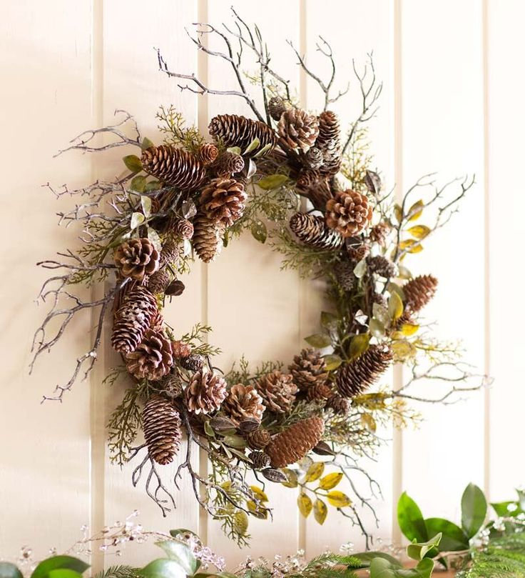 Shimmering Winter Pine Cone Wreath   Wreaths - this one has 'lightly dusted with white snow-like finish' - look for one without that, with bare branches sticking out
