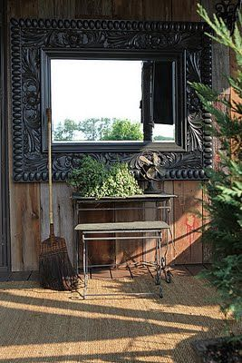 a mirror... makes everything bigger and brighter .. inside or out.. even on the porch or a fence