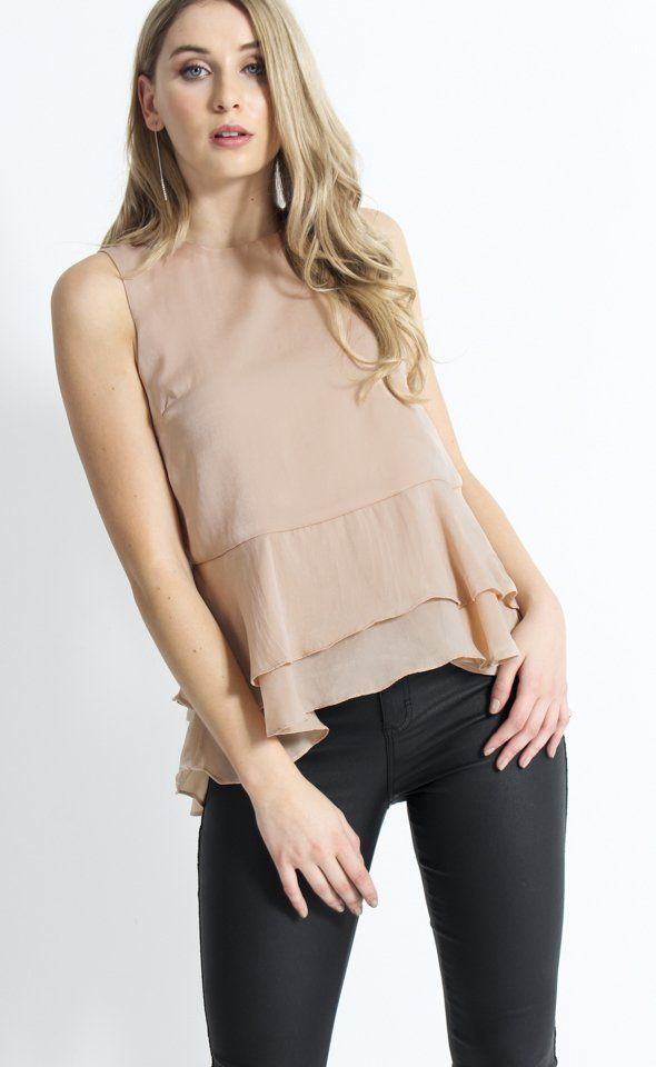 Satin Peplum Ruffle Top | This style features a double layered ruffle hem for pretty movement that will compliment your silhouette. Pair with a tailored pant and heels for a smart work-ready look.