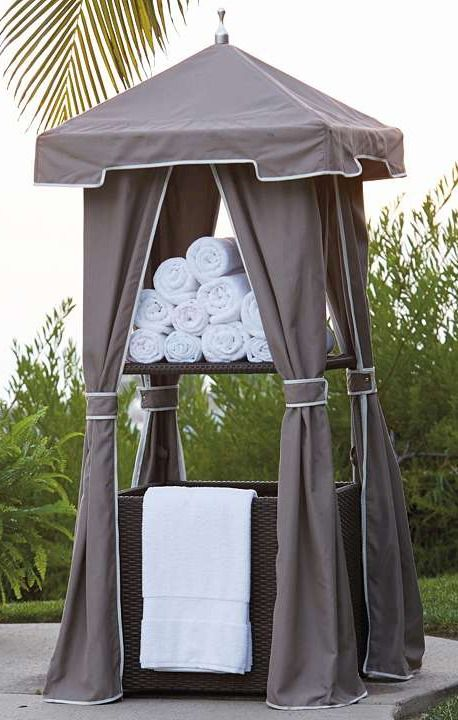 Woven wicker towel valet towels love this and so cute for Outdoor towel caddy