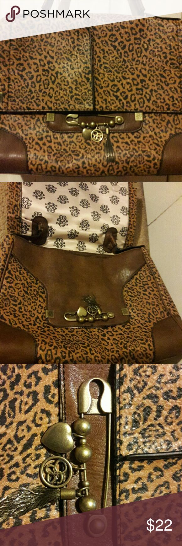 Jessica Simpson animal print handbag New with tag, never used. Hidden compartment cute charms Jessica Simpson Bags Shoulder Bags