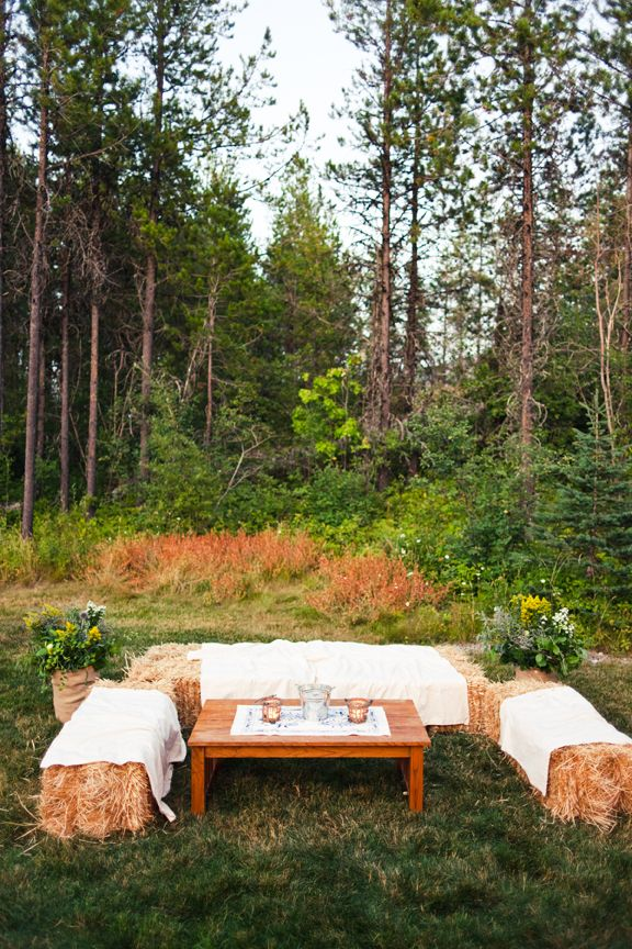Simple straw bale cocktail lounge with coffee table.  (Glacier Park Weddings, Alicia Brown Photography)