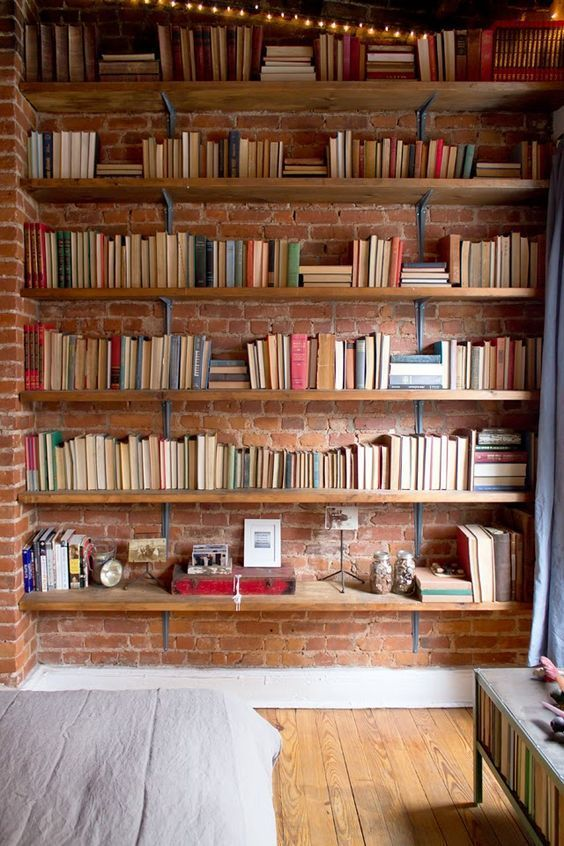 Amazing idea for home library - shelves on the exposed brick wall
