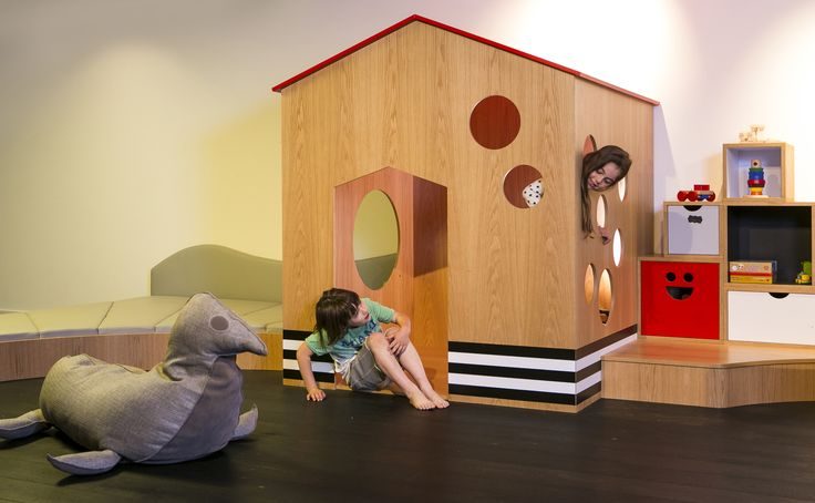 Indoor fun play room located in a privte house basement, designed in a modern contemporary style to promote play and inspire kids imagination