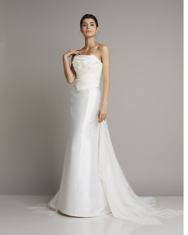 Slim strapless wedding dress of silk with asymmetrically ruched bodice and train made of transparent tulle of Giuseppe Papini