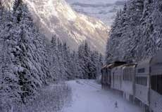 The Snow Train travels through the Rockies in winter.