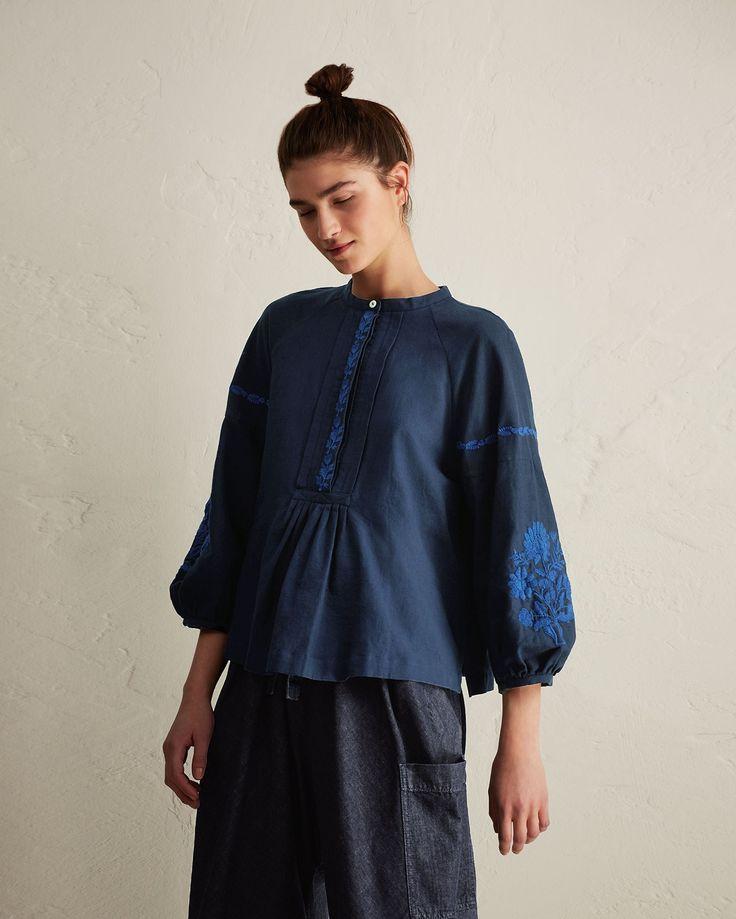 Embroidered cotton khadi. Button placket with gathers below. Bracelet-length balloon sleeves. Split hem.