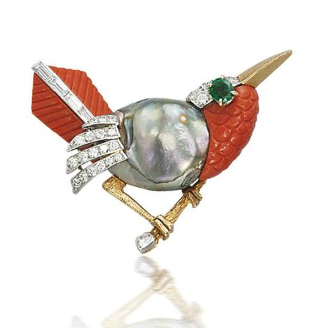 A MULTI-GEM AND DIAMOND BIRD BROOCH, BY CARTIER  Designed as a stylized robin on a gold branch, the body as a baroque silver coloured cultured pearl, with carved coral tail and breast, emerald eye and diamond detail, circa 1960, 4.8 cm, with French assay marks for platinum and gold