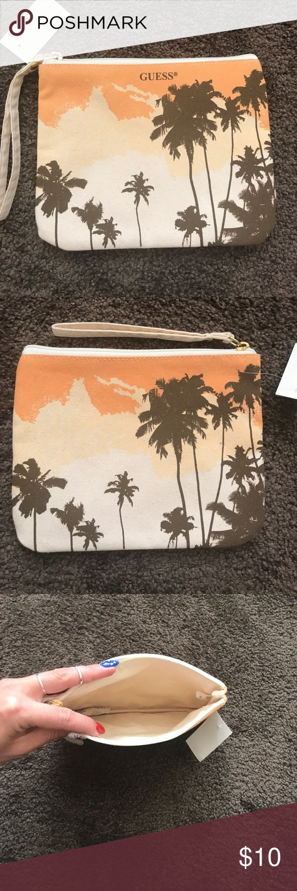 Guess small cosmetic bag Brand new so cute!! Palm tree guess cosmetic bag/clutch with zipper and handle Guess Bags Cosmetic Bags & Cases
