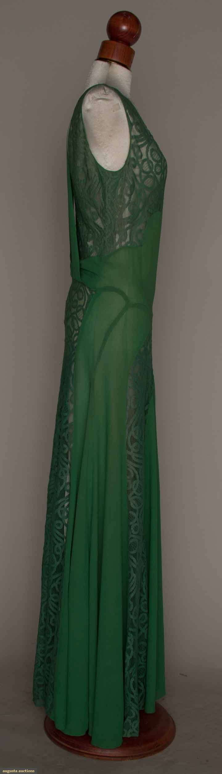 GREEN SILK & LACE GOWN, MID 1930s Silk crepe, bias piecing, sleeveless, CB & F panels of green tape lace, attached crepe back belt & halter. Sideway