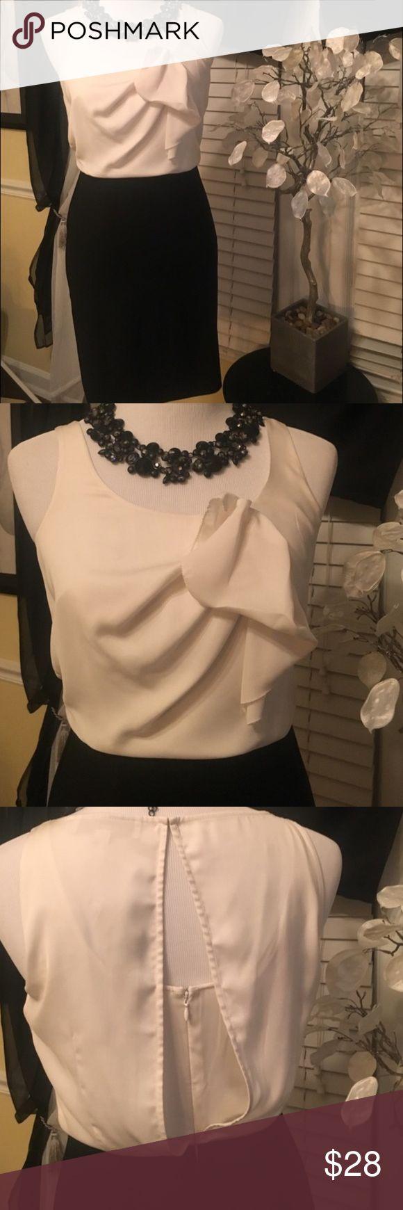 LOFT black and white sleeveless dress Ann Taylor LOFT sleeveless dress. Petite size 0P. Black and white. LOFT Dresses