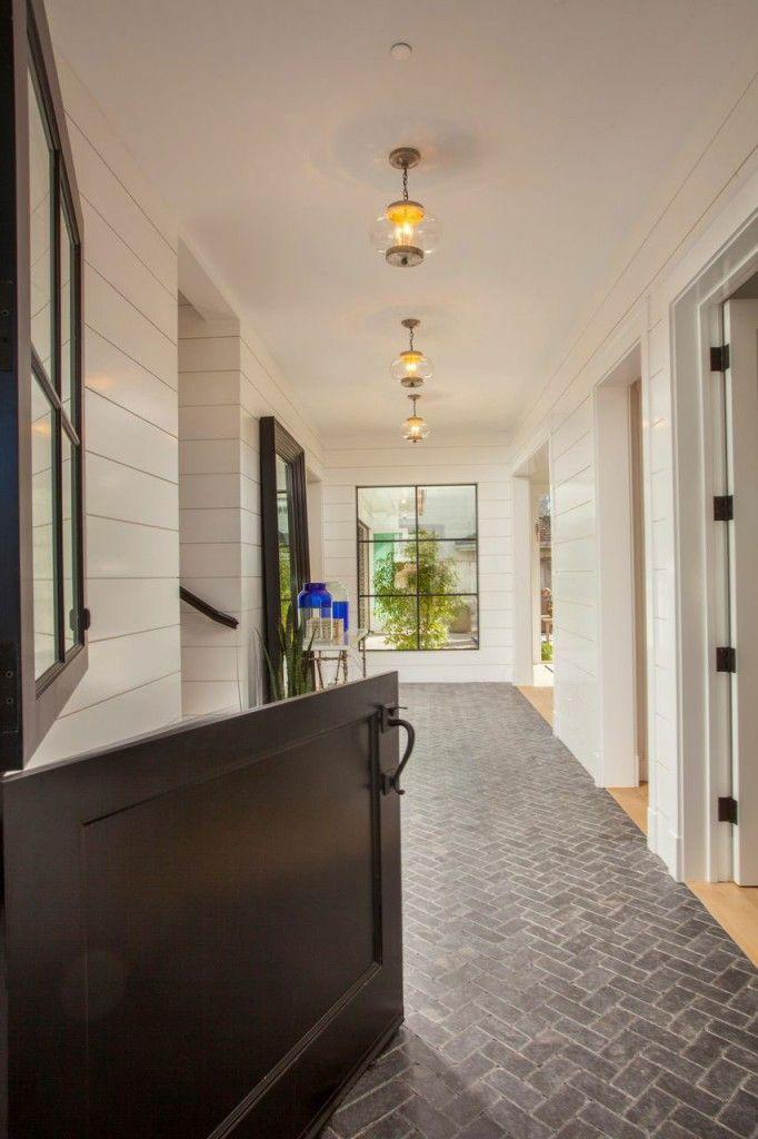Chic hallway. Love the herringbone flooring and black doors - Blackband Design