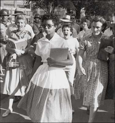 """Elizabeth Eckford, shown in this famous picture, was one nine blacks students who attended and integrated Central High School in Little Rock, Arkansas in 1957. Known as the """"Little Rock Nine,"""" these students were subjected to ridicule, bullying, and humiliation by their classmates to the point where federal troops were sent to escort them."""