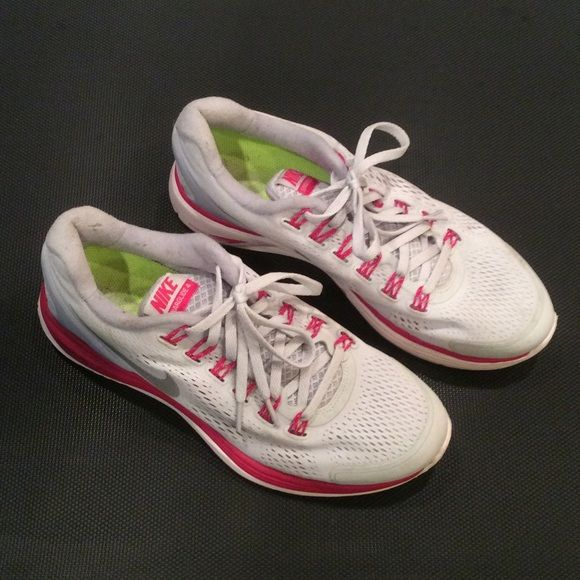 Womens Nike Lunar Glide size  8. Gently used and very clean. Gray and pink wth green interior.