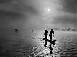 Stand up water transport, propelled by paddle or pole is ancient.  Fisherman on Piulaga Lake in Mato Grosso, Brazil, shot by Sebastiao Salgado Genesis in 2005, from his Taschen book Genesis.