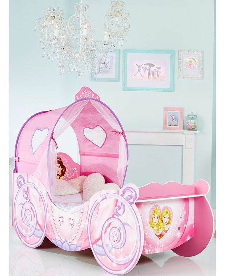 Make the move to her first big bed magical with this Disney Princess Carriage Toddler Bed. The toddler bed is every little girl's dream come true with its canopy and twinkling lights and Disney Princess detailing. The perfect height for little legs to hop up on, the delightful Disney Princess Carriage Toddler Bed is practical too, with protective side panels to stop bedtime tumbles.