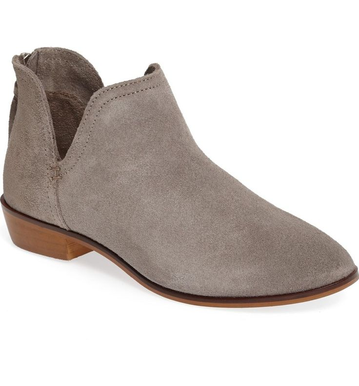 A split shaft and a simple almond toe detail this versatile, understated bootie lifted slightly by a modest setback heel.