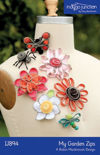 """Create a fanciful garden of delightful flowers and little friends from zippers. Recycle those old metal zippers into a charming array of brooches that will add a little """"zip"""" to your wardrobe."""