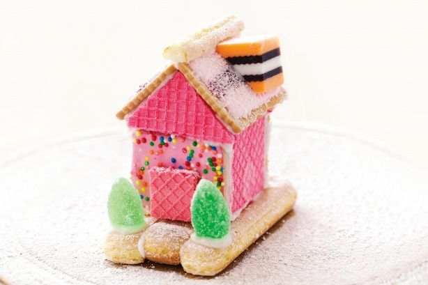 Here is a simpler version of the traditional gingerbread house which the kids can help put together using store bought favourites.