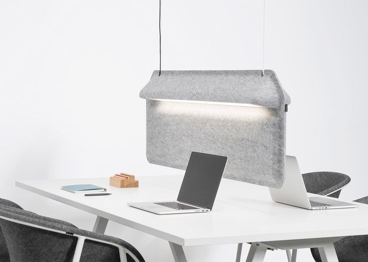 Dutch brand De Vorm's combined lamp and desk partition has been designed to add some privacy to crowded open offices
