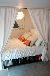 If your bed is in a nook or very small room, you can turn it into a ship-shape hideaway with some curtains. | 17 Ways To Make Your Bed The Coziest Place On Earth