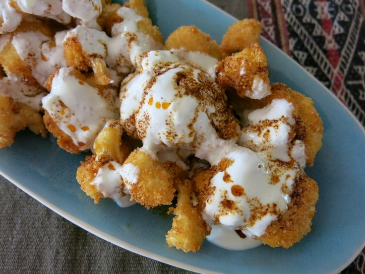 Breaded Cauliflower with Garlic Yoghurt and Burnt Chilli Dressing from VegFusion