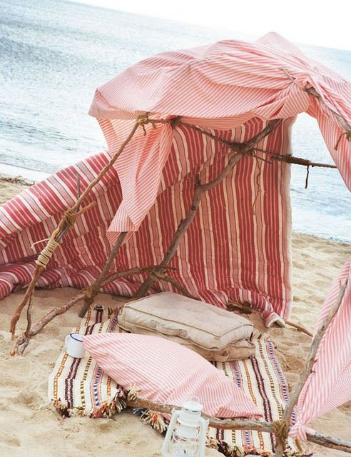 Boho beachside lounge with carpets & pillows.