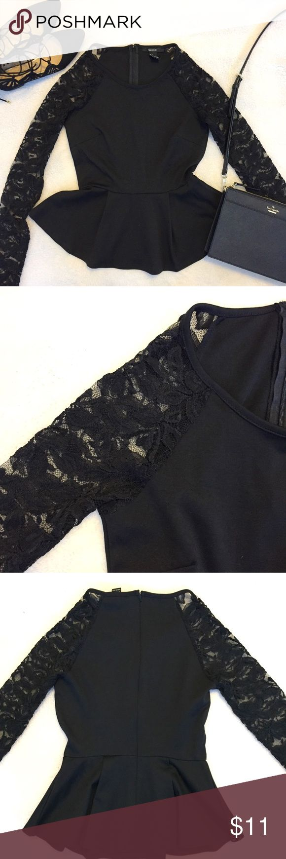 Forever 21 Lace Peplum Top Super cute black peplum top with lace sleeves! The back zips up so it's no problem getting on. Perfect for a night out! Fits like a small/xs. Forever 21 Tops Tees - Long Sleeve