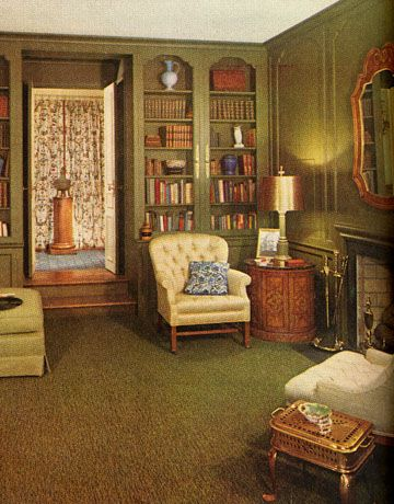 Another Example of 60s interior design. Darker than most. Green Wood Paneled room. Still see light blue and yellow accents.