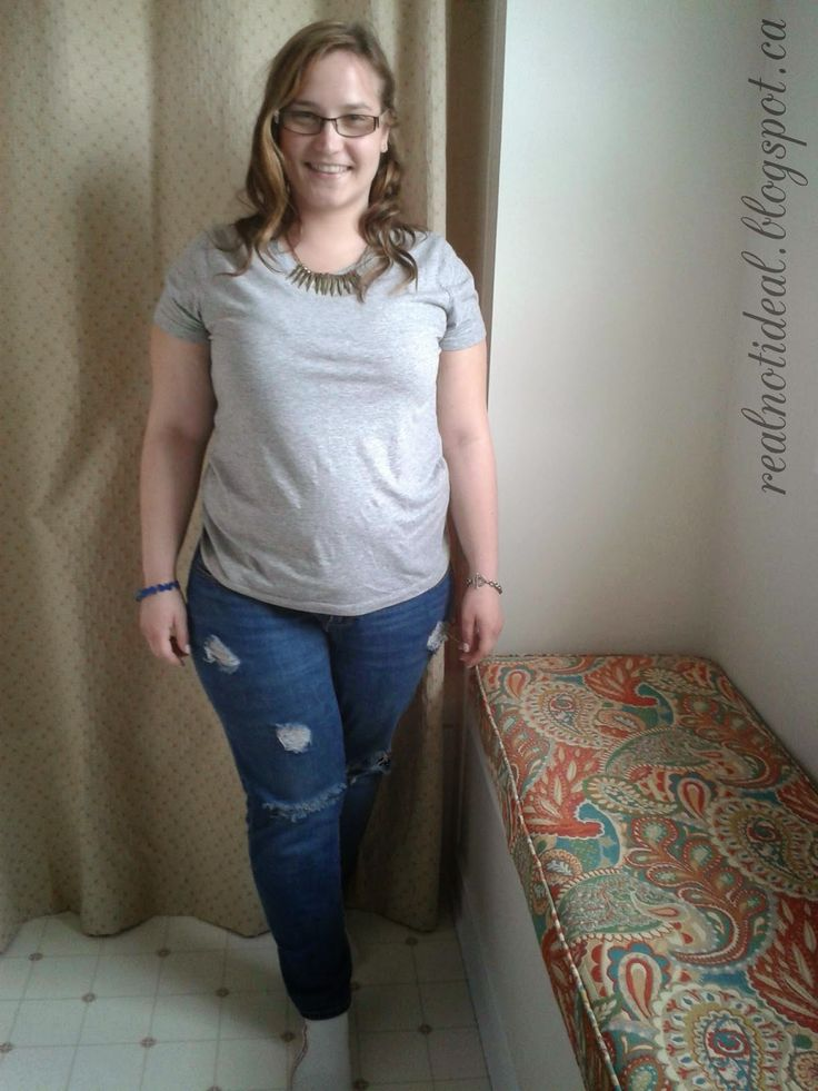 Grey t-shirt, statement necklace, ripped jeans. *good casual bar outfit*