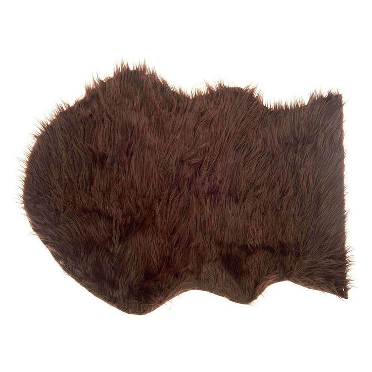Maak het knus in huis met dit zachte donkerbruine imitatievachtje. Leuk voor op de bank, stoel, onder een klein bijzettafeltje of voor de open haard. Afmeting: 60 x 90 cm - Schapenvacht Donkerbruin