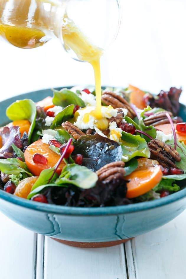 Winter Salad with Citrus Vinaigrette is topped with goat cheese and crunchy pecans. A delight to your senses.