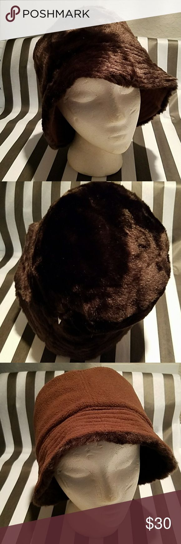 Reversible Chocolate faux fur/fleece bucket hat Offered is a reversible chocolate faux fur on one side and mocha fleece on the other bucket hat. New without tags and in immaculate condition. Elegant faux fur is animal friendly and luxurious. This would look stunning paired with the faux leopard cuffed knit gloves I have for sale,  listed separately. Look sexy and keep Warm! Winter is here! Accessories Hats