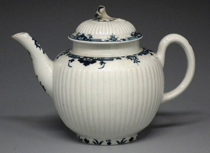 Worcester teapot and cover circa 1770 the : Lot 0134   Worcester teapot and cover circa 1770 the ribbed body painted with underglaze blue borders, crescent mark to base, (2) 14cm high Condition report: Old restoration to the finial. Minor chip to the spout.