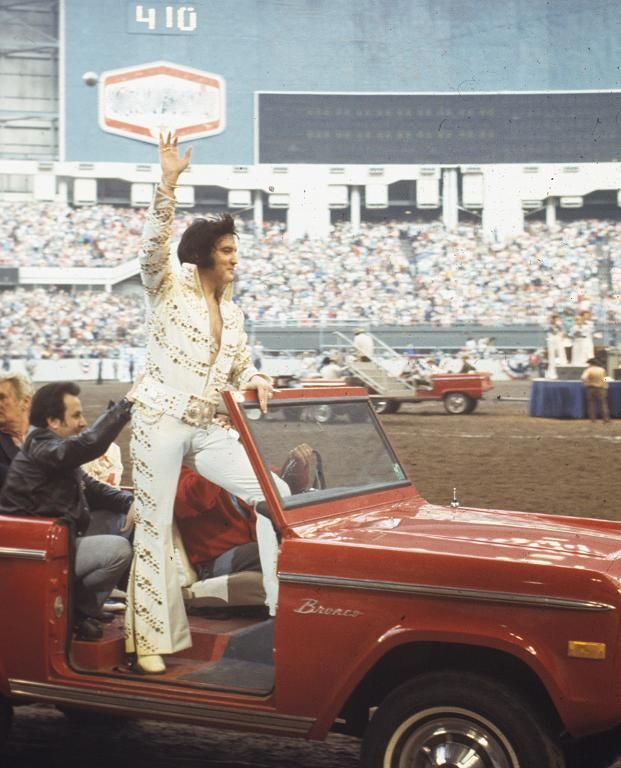 THE KING OF ROCK & ROLL.  Elvis Presley waves at the sell-out rodeo crowd - Houston Stock Show & Rodeo - Astrodome - Houston, Texas.