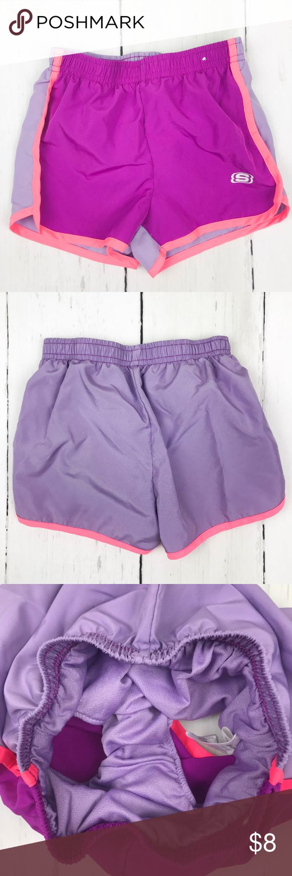Girls Skechers Purple Lined Active Shorts Size 5/6 These active wear shorts are lined and have an elastic waist. Great for casual wear, bathing suit cover ups, and sports such as soccer, they are lightweight and easy to wear!   From Skechers. Size 5/6. 100% polyester Machine wash cold gentle cycle, tumble dry low. Skechers Bottoms Shorts