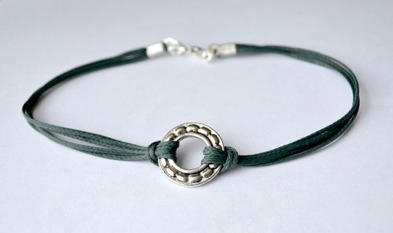 Men's Karma bracelet with silver circle charm and a by Principles, $9.00