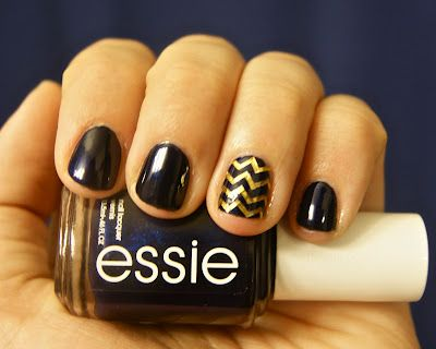 black + gold chevron nails