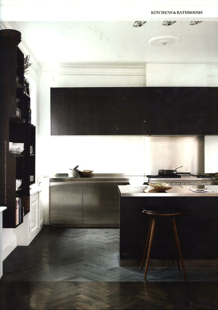 -A minimal kitchen, but dark and more rich/homey. I enjoy this. I think a kitchen deserves to be homey. .