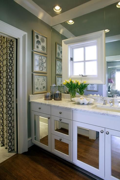 fantastic bathroom features walls clad in green gray grasscloth lined with a white vanity with fitted