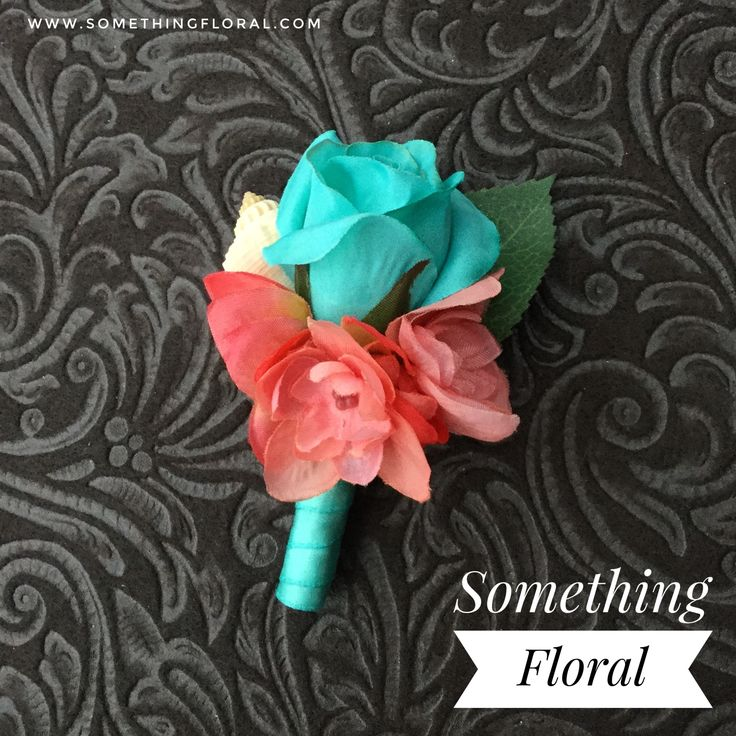 Aqua / teal rose, coral hydrangea, and sea shell boutonniere finished with Tiffany blue ribbon. #seashell #boutonniere Great for a beach or destination wedding.