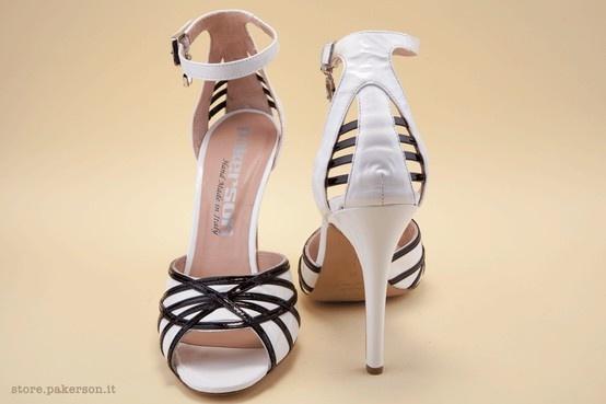 The 10-cm leather heel makes this sandal a glamorous choice for lending a dash of brio to one's bearing and natural elegance.  - Il sofisticato tacco 10 in cuoio fa di questo sandalo una scelta glamour che esalta il portamento e l'eleganza. http://store.pakerson.it/high-heel-sandals-27297-bianco-nero.html
