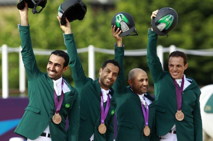Hrh Abdullah Al Saud, Kamal Bahamdan, Ramzy Al Suhami and Abudallh Waleed Sharbatly of Saudia Arabia winning their bronze medals for horse jump..