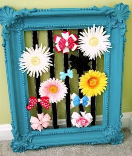 Hair Bow Holder  Paint an old picture frame  Flip the frame over and measure ribbon to stretch from top to bottom with a little extra and hot glue (I'd use a staple gun if your frame is made of wood) the ribbon, evenly spaced  (about 2 inches apart) to the top.Then, when the glue is dry, glue it (or staple it) straight to the bottom of the frame. Let dry and finally, attach all of those little girly hair bows that are floating around your house