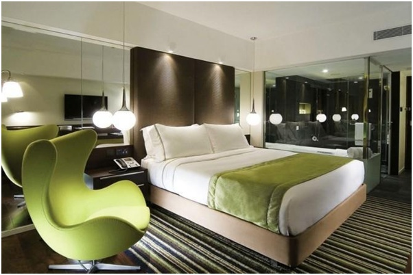 Room 2-The Mira Hong Kong Hotel S.A.R China -Rooms at The Mira Hong Kong redefine pared-down luxe, with vibrant colours, spacious interiors, ambient lighting and the newest on-demand features,from the Arne Jacobsen Egg Chair view your Sony LCD TV.