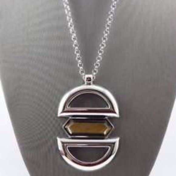 """Magnetic Necklace A baguette of genuine tiger's eye seems to hover between two hemispheres of smooth polished silver. Its allure is no mystery. Adjustable pendant necklace 32-35"""". New with tags and gift box. Jewelry Necklaces"""
